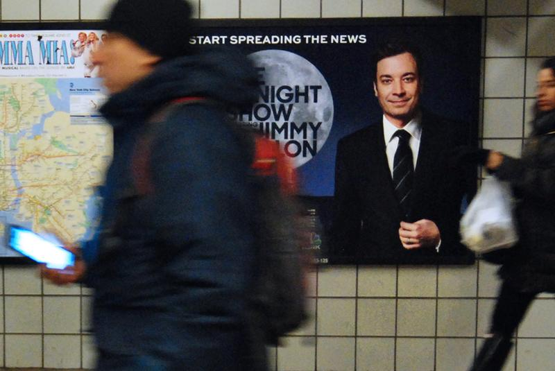 A poster announcing the premiere of The Tonight Show with Jimmy Fallon hangs in the 42nd/Port Authority subway station.