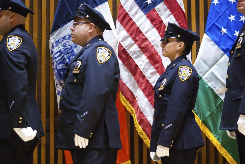 NYPD officers wait in line during a ceremony at One Police Plaza.