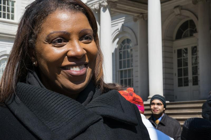 NYC Public Advocate Letitia James talks to press after a city hall rally.