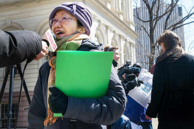 Manhattan Councilwoman Margaret Chin talks to press and advocates at a rally on the steps of City Hall.