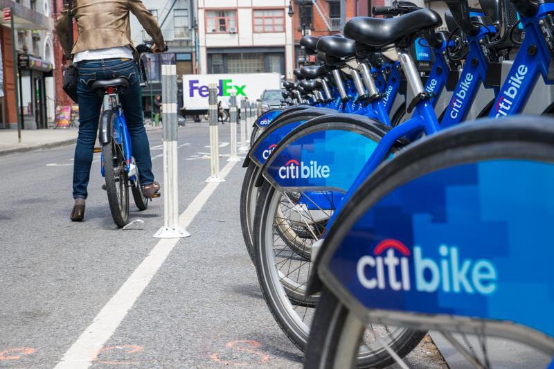 A woman checks a bike out from a Citi Bikes station in lower Manhattan.