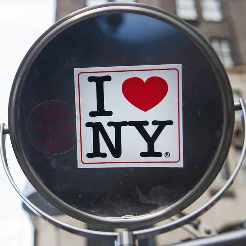 "An ""I heart NY"" sticker on a vendor's mirror near Central Park."