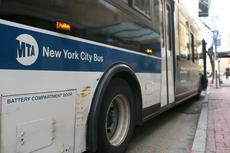 An MTA bus waits to merge into traffic
