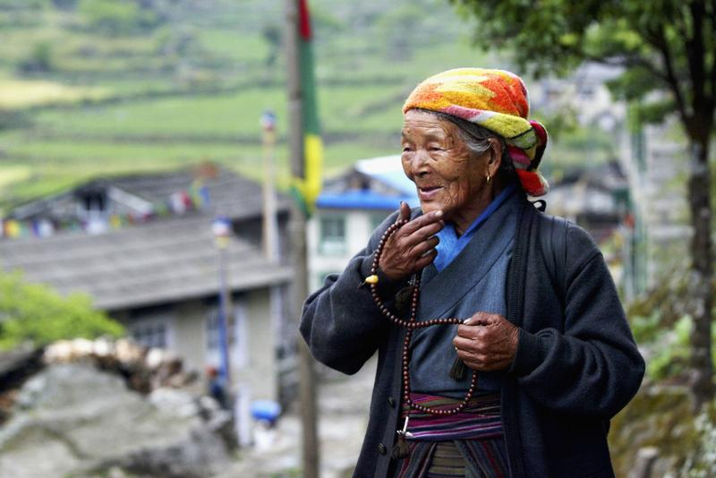 An elderly Sherpa woman holds her prayer beads May 25, 2003 in Phakding, Nepal in the Solu Khumbu region.