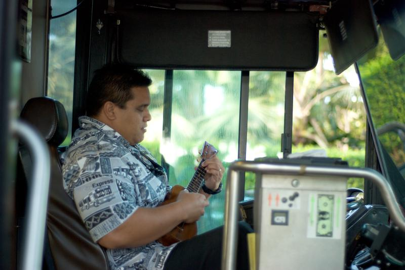 A bus driver in Waikiki, pausing to play the ukelele