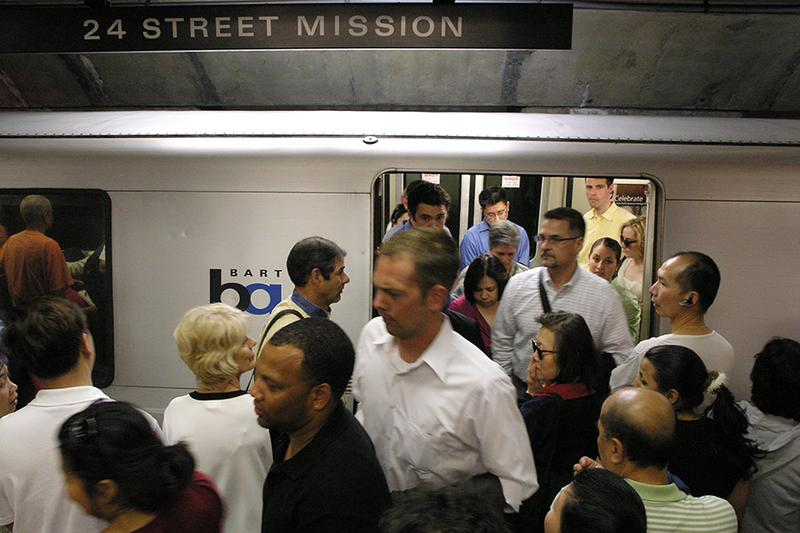 A packed BART train pulls up to the station in San Francisco