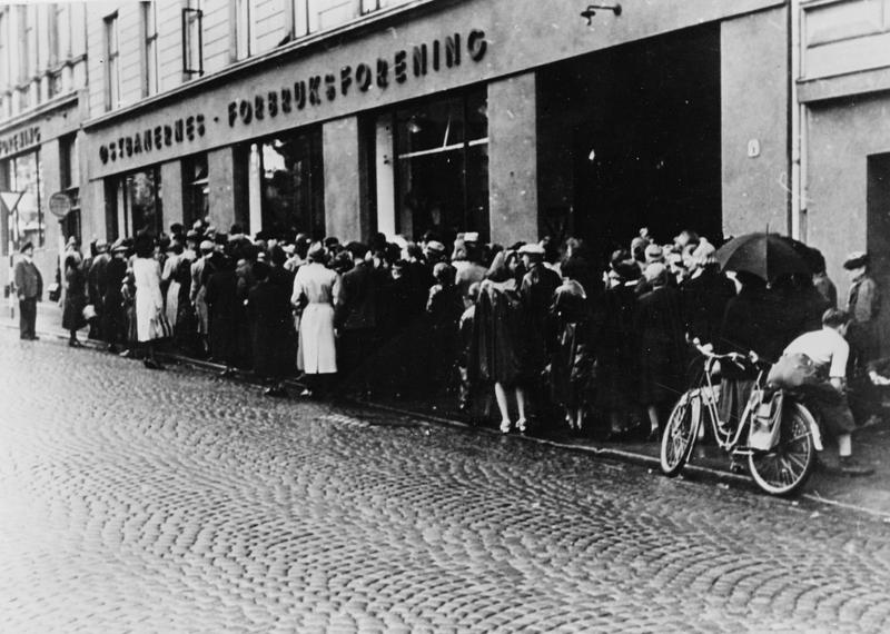 Norwegians wait for food rations in Oslo during occupation-induced food shortages, 1942