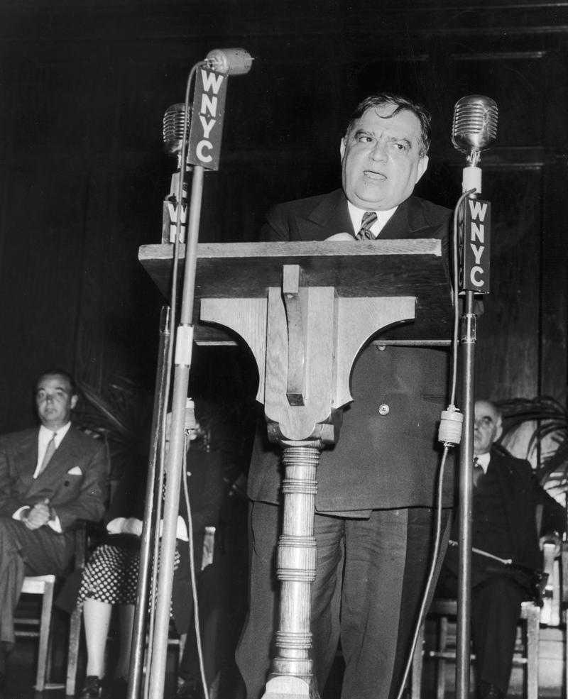 New York City mayor Fiorello La Guardia in 1943 makes a dedication speech from a podium at the opening of the Fort Green Housing Development for war workers, Brooklyn.