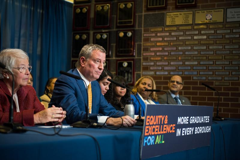 Mayor Bill de Blasio fields questions about the investigations into his administraiton during an event about high school graduation rates