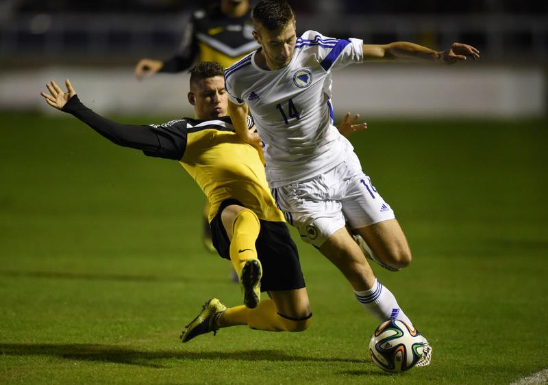 Bosnia-Herzegovina's midfielder Tino Sven Susic dribbles the ball past a defender during a friendly with Santos U-21 in Sao Paulo ahead of the 2014 World Cup.
