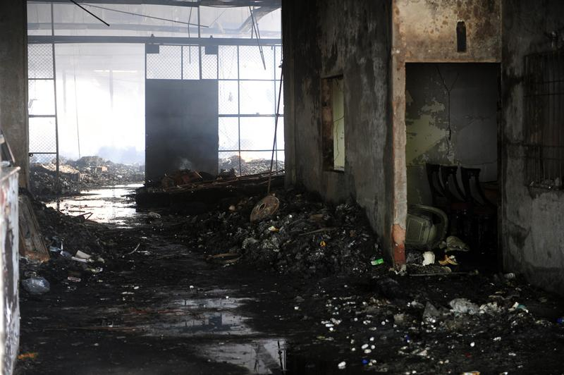 A view of the damaged premises of a cold-storage cargo facility at the Jinnah International Airport in Karachi on June 10, 2014.