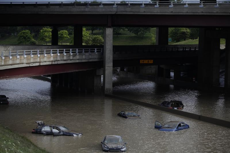 Vehicles submerged in water along I-75 in Royal Oak, Michigan