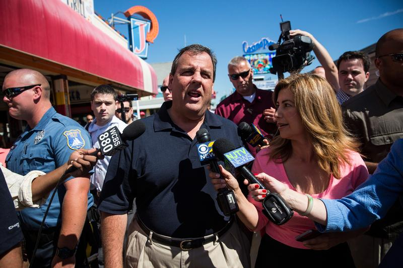 New Jersey Governor Chris Christie takes questions from the media while touring the boardwalk in Seaside Heights, New Jersey.