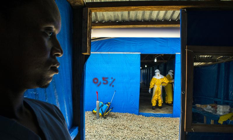 James Momoh stands by as colleagues enter the suspected ebloa case ward Bong County Ebola Treatment Unit, on Tuesday September 16, 2014.