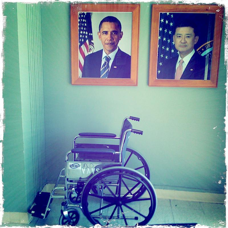 A wheelchair sits in a corner at a Veteran's hospital.
