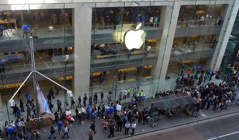 Customers queue outside an Apple store to buy the iPhone 6 in Sydney on September 19, 2014. Hundreds of people queued through the night in Sydney.