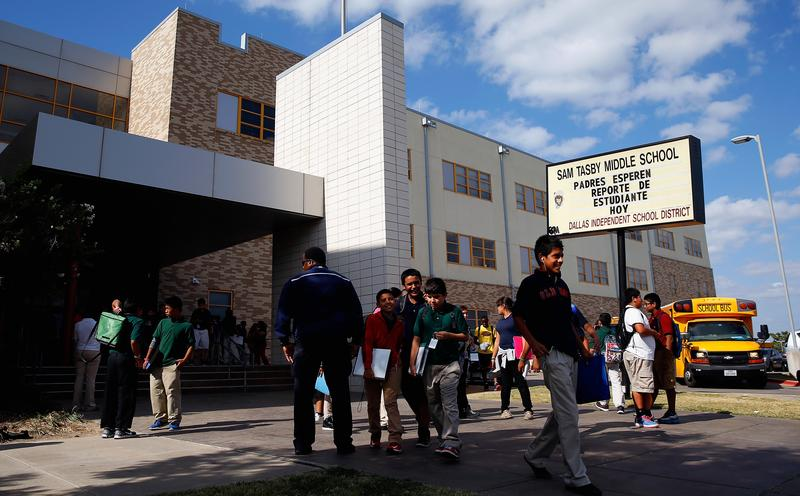 Students are dismissed from Sam Tasby Middle School on October 1, 2014 in Dallas, Texas. Officials confirmed that a student, who had contact with the first confirmed Ebola virus patient in the United