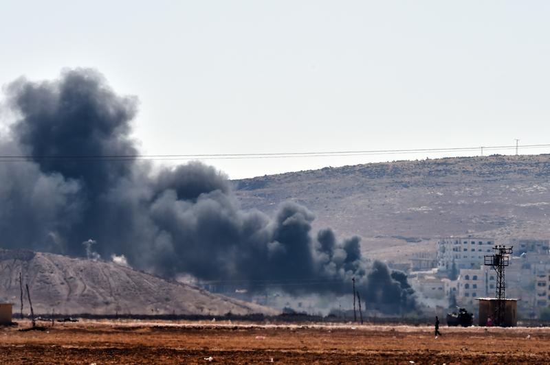 Smoke rises from the Syrian town of Ain al-Arab, known as Kobani by the Kurds, on the Turkish-Syrian border on October 6, 2014.