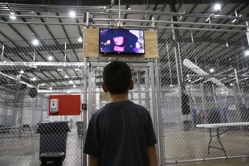 boy from Honduras watches a movie at a detention facility run by the U.S. Border Patrol on September 8, 2014 in McAllen, Texas.