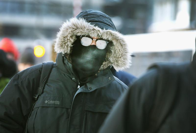 Commuters make a sub-zero trek to offices in the Loop on January 6, 2014 in Chicago, Illinois. Temperatures in the city dipped to -16 degree Fahrenheit this morning on the heals of a polar vortex.