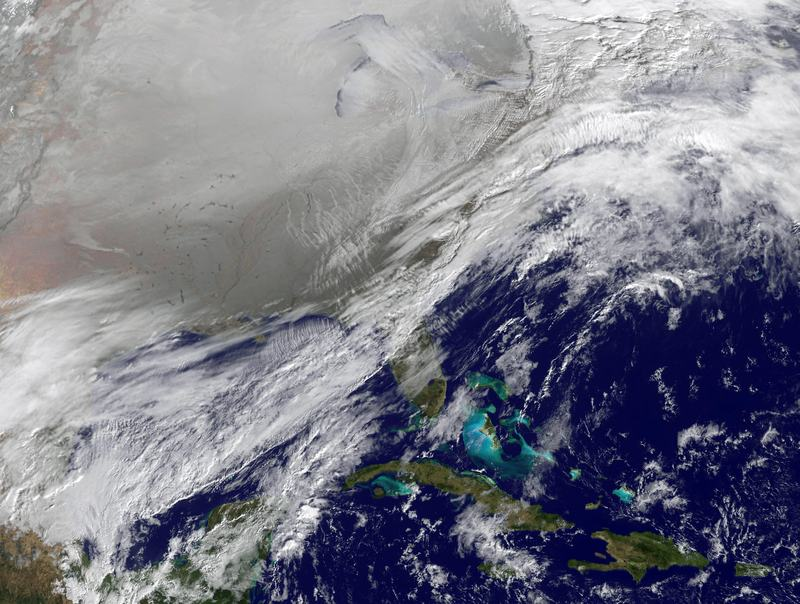 In this satellite handout image provided by NOAA, shows the entry of a large area of low pressure, from the Polar Vortex, into the Northern U.S. January 6, 2014.