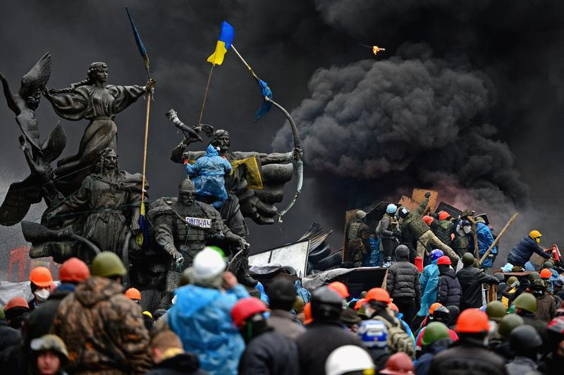 Anti-government protesters continue to clash with police in Independence square, despite a truce agreed between the Ukrainian president and opposition leaders on February 20, 2014 in Kiev, Ukraine.