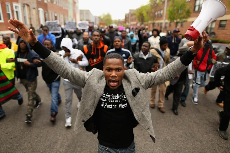 Hundreds of demonstrators march toward the Baltimore Police Western District station during a protest against police brutality and the death of Freddie Gray in the Sandtown neighborhood April 22, 2015