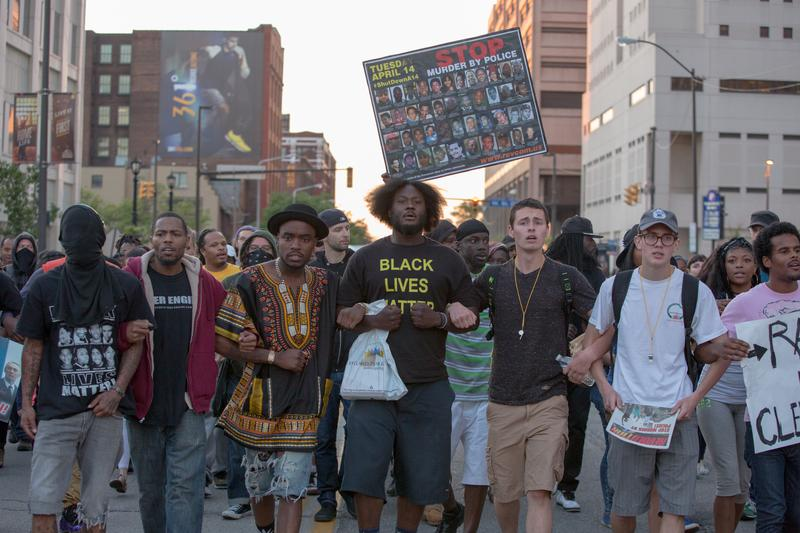 People walk down the middle of E. 9th St. and protest in reaction to Cleveland police officer Michael Brelo being acquitted of manslaughter charges. ay 23, 2015 in Cleveland, Ohio