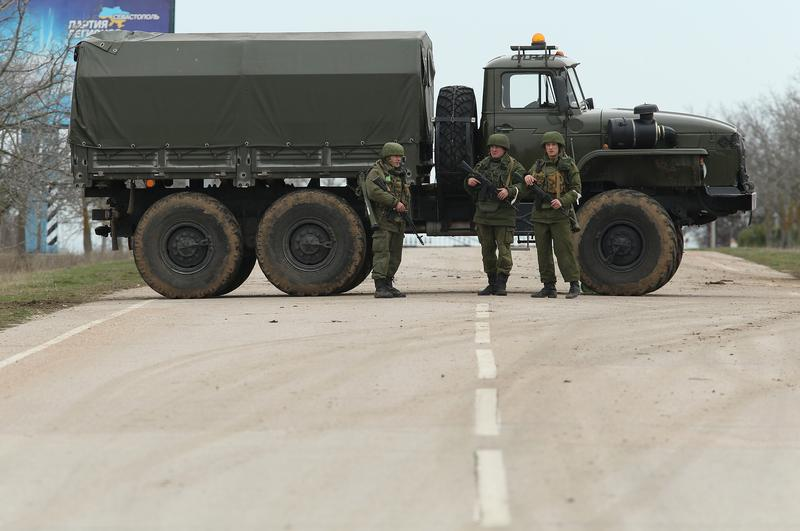 A truck and soldiers block the road leading to Babek Airport near Sevastopol that is occupied by Russian troops in Crimea on March 2, 2014 near Balbek, Ukraine.