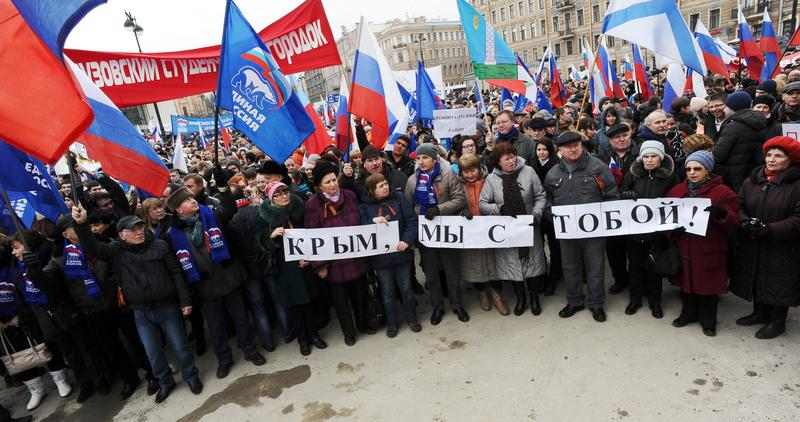 Pro-Kremlin activists rally in support of ethnic Russians in Ukraine's Crimea in St. Petersburg, March 2, 2014. The poster reads: 'We are with you Crimea!'