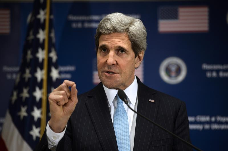 US Secretary of State John Kerry gestures during a press conference held at the US Embassy in Kiev on March 4, 2014. Kerry accused Russia on March 4 of looking for a 'pretext' to invade Ukraine.