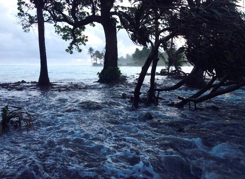 A high tide energized by storm surges washes across Ejit Island in Majuro Atoll, Marshall Islands on March 3, 2014, causing widespread flooding and damaging a number of homes.