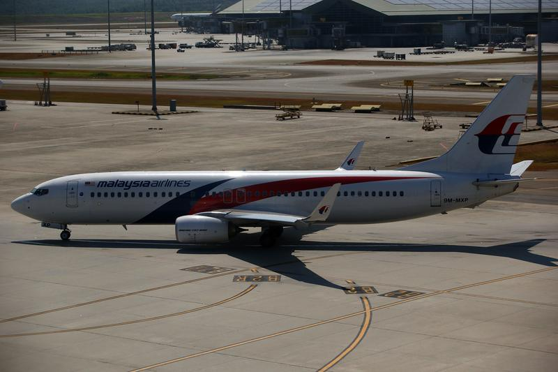 A MAS plane is seen on the tarmac on March 11, 2014 in Kuala Lumpur, Malaysia. Officials have expanded the searh area for missing Malaysia Airlines flight MG370.