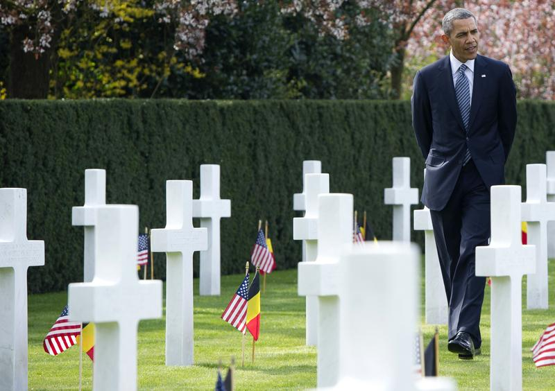 President Barack Obama visits the WWI Flanders Field Cemetery in Waregem on March 26, 2014. The cemetery is the final resting place for 368 Americans, most of whom were killed during World War I.