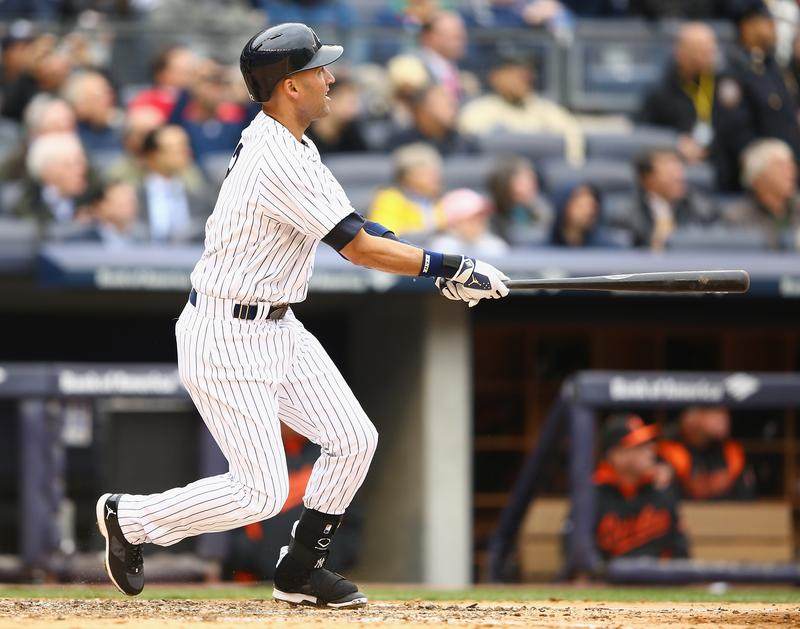 Derek Jeter of the New York Yankees hits a double against the Baltimore Orioles in the fifth inning during their game on April 7, 2014 at Yankee Stadium
