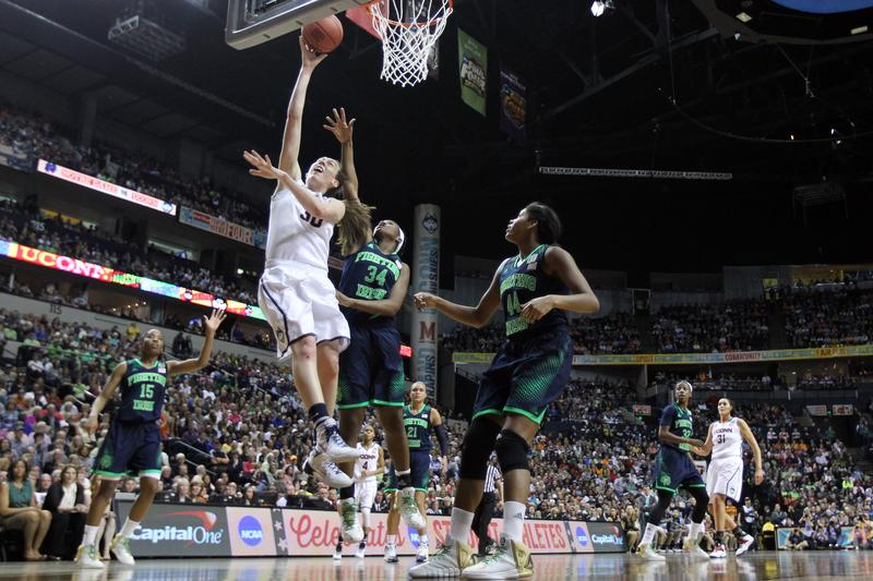 Breanna Stewart #30 of the Connecticut Huskies shoots the ball against Markisha Wright #34 of the Notre Dame Fighting Irish during the NCAA Women's Final Four Championship. April 8, 2014