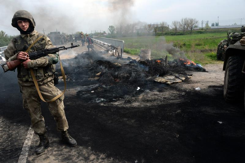 A Ukrainian soldier stands guard near a checkpoint which troops seized in the early morning in the village of Andreevka, near the southern Ukrainian city of Slavyansk, on May 2, 2014.