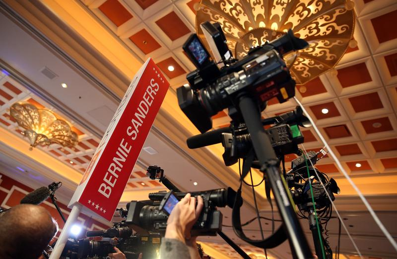 Cameras are raised in the air and aimed at Democratic presidential candidate Sen. Bernie Sanders (I-VT) (not pictured) as he is interviewed in the spin room after a presidential debate.