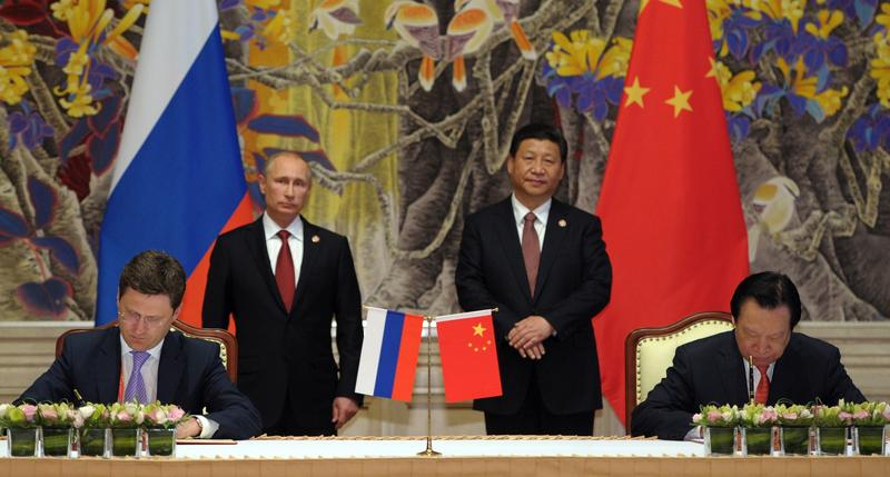 China's President Xi Jinping (back R) and Russia's President Vladimir Putin (back L) attend an agreement signing a monumental, multi-decade energy deal in Shanghai on May 21, 2014.