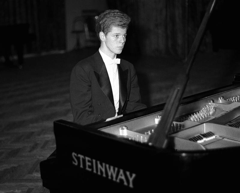 This April 11, 1958 file photo shows pianist Van Cliburn performing in final round of Tchaikovsky International Piano & Violin competition in Moscow.