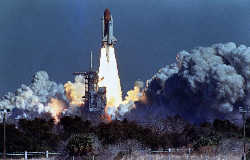 US space shuttle Challenger lifts off 28 January 1986 from a launch pad at Kennedy Space Center, 72 seconds before its explosion killing it crew of seven.