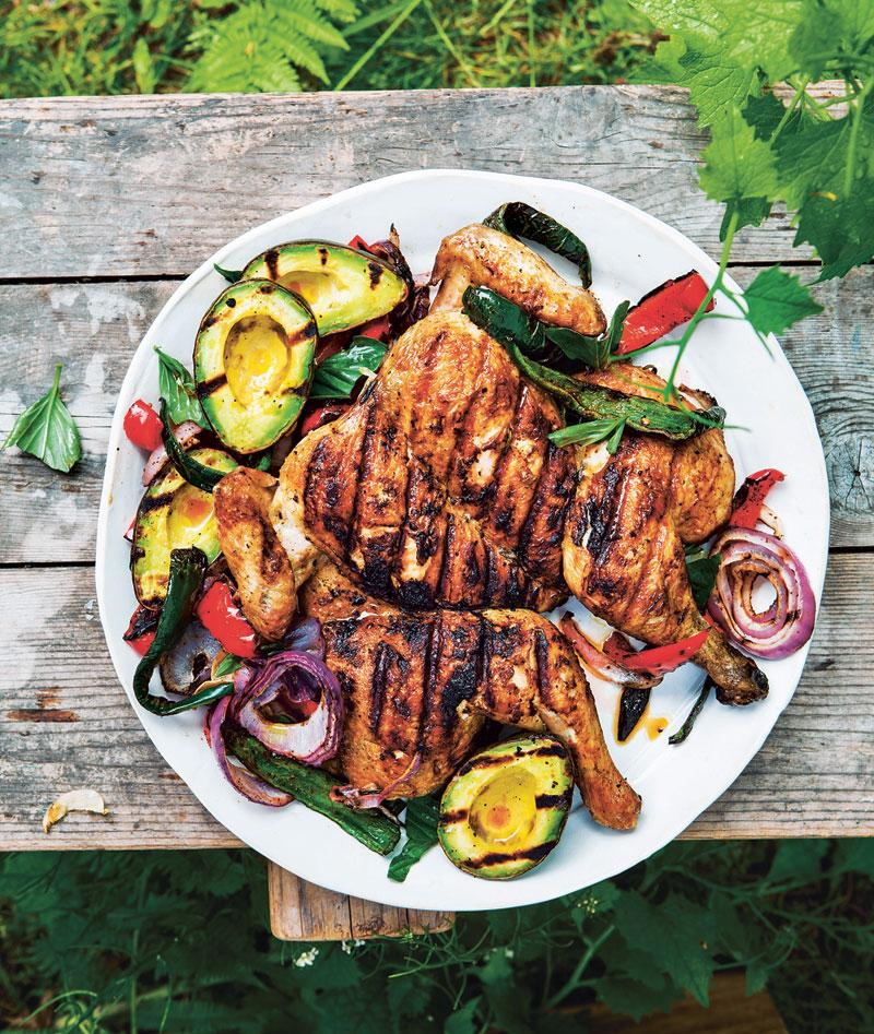 Chicken under a brick with grilled avocados and chiles