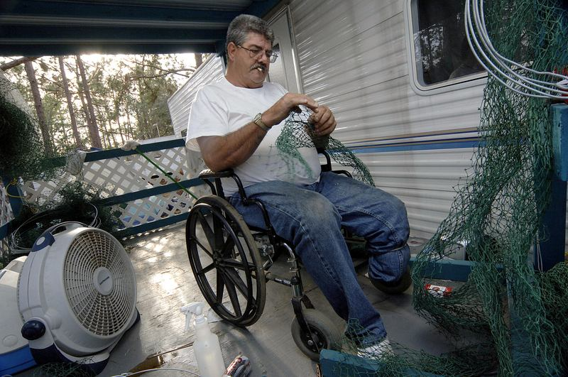 Billy Arceneaux of Biloxi, MS has diabetes and is handicapped by the loss of a leg. November 14, 2005