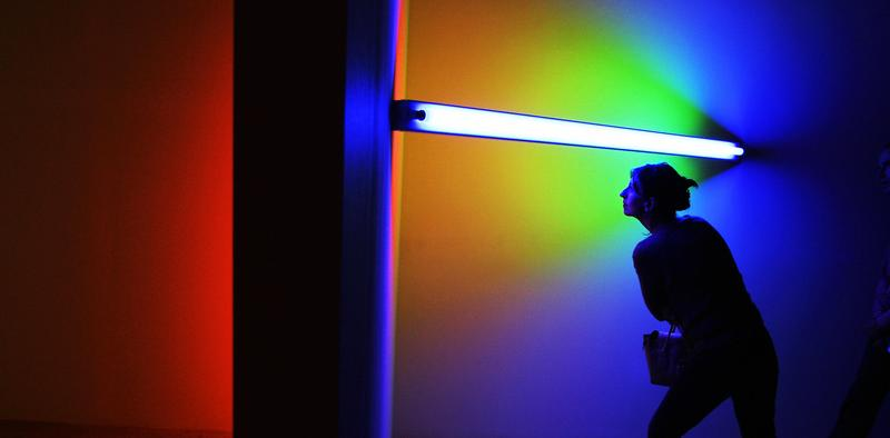 A woman inspects the artwork by American artist Dan Flavin (1933-1996) in The Hayward Gallery in London, 18 January 2006.