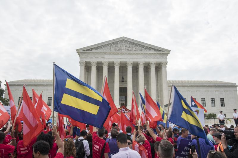 Marriage equality supporters rally on the steps of the Supreme Court as they wait for a decision, Friday, June 26, 2015 in Washington.