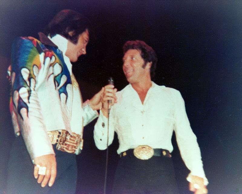 Tom Jones in a belt buckle competition with Elvis.