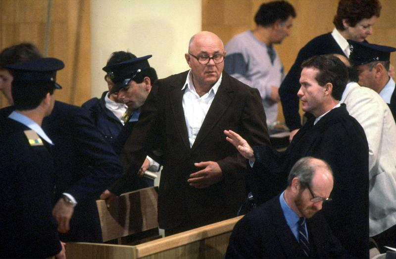 John Demjanjuk (C), 81-year-old retired auto worker living in Cleveland, OH, charged as a Nazi death camp guard, appears in a courtroom at the start of his trial February 16, 1987 in a Jerusalem.