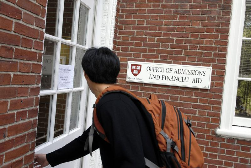 Freshman Winston Yan enters the Admissions Building at Harvard University September 12, 2006 in Cambridge, Massachusetts.