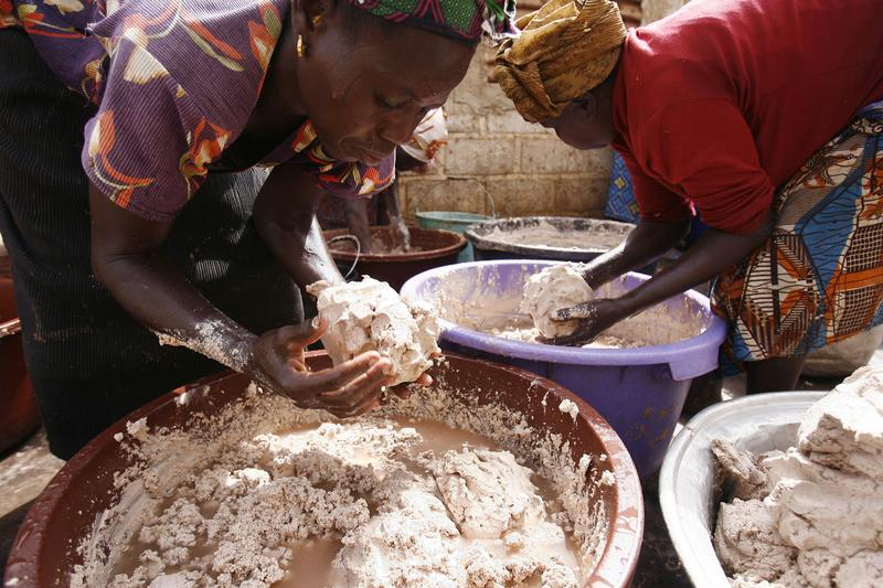 Women from a cooperative in Ouagadougou, Burkina Faso prepare butter for use in cosmetics exporter to Europe and the United States.