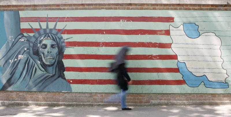 An woman passes by a mural on the wall of the former US embassy in Tehran. Militant students stormed the U.S. embassy on November 4, 1979, and held 52 Americans hostage for 444 days.